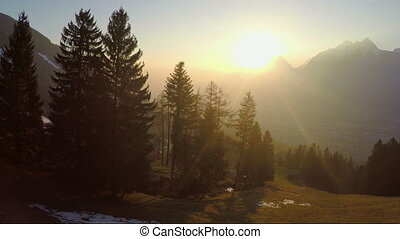 """Fantastic golden sun rays shining in mountains, magic atmosphere, little village"""