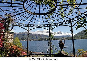 scenery of lake Como ( Lago di Como called also Lario) seen from gazebo in historic Garden of Villa Carlotta, Tremezzo, Lombardy, Italy, Europe