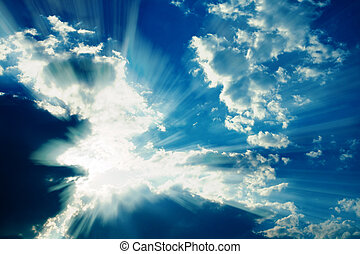Fantastic sun rays striking through clouds. Graphic effects are applied for a more dramatic image