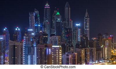 Fantastic rooftop skyline of Dubai marina timelapse. -...