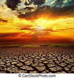 fantastic sunset over cracked earth