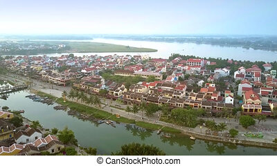 Hoi An old district roofs lit by morning sunlight -...