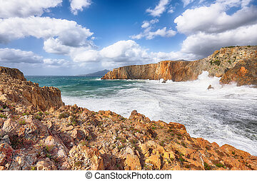 Fantastic view of cliffs in valley Cala Domestica and storm on the sea.