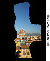 Fantastic View of the cathedral of Florence  through stone window in tower of Palazzo Vecchio , Italy