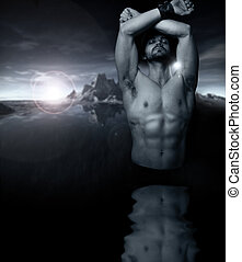 Fantastical stylized fine art portrait of a shirtless man emerging from reflective water with setting sun and mountains in background