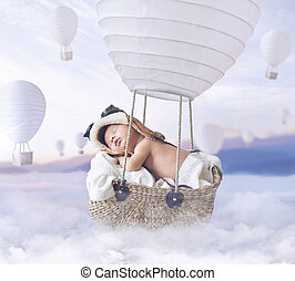 Fantasty image of little boy flying a balloon