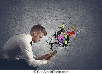 Concept of fantasy book with ink spray
