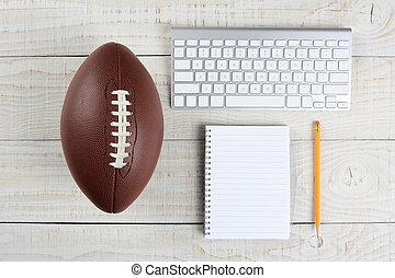 Fantasy Football Draft still life. A computer keyboard, pad ...