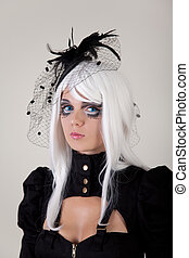 Fantasy girl with creative make-up and blue contact lenses