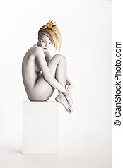 Fantasy. Harmony. Beauty Muse sitting over White Background....