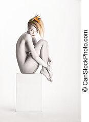Fantasy. Harmony. Beauty Muse sitting over White Background....