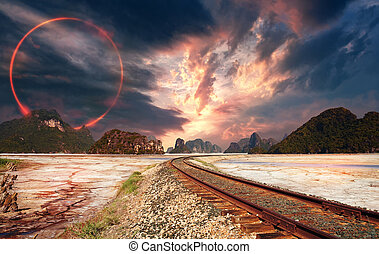 Fantasy landscape and red circle in the sky