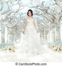 Fantasy. Matrimony. Bride in White Dress over Frozen Winter Trees and Snowflakes