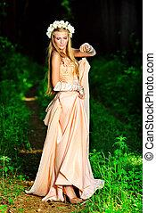 fantasy - Portrait of a dreamy fairy girl outdoor.