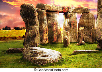 Fantasy sunrise at Stonehenge with dramatic sky and sun rays