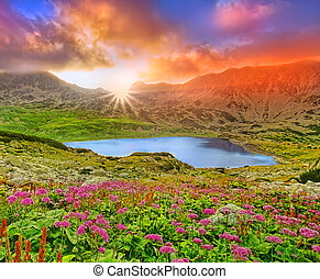 fantasy sunset landscape with mountain and lake.