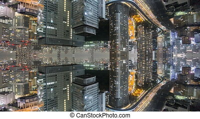Fantasy time-lapse of tokyo city skyline with mirrored office buildings
