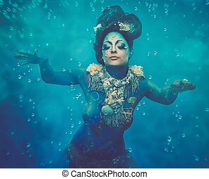 Fantasy underwater woman creature with body art