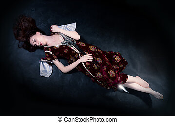 Fantasy woman lying on the ground with sword