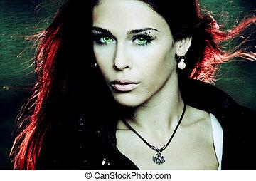 fantasy woman portrait with red back light, studio shot