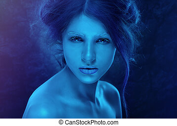 Fantasy woman with blue frost makeup and skin