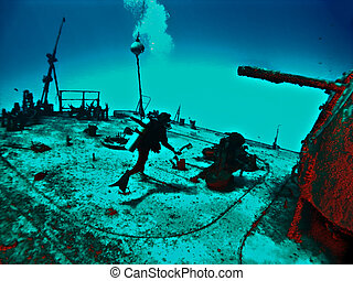 Fantasy Wreck Diver exploring the Deck of a Sunken Ship