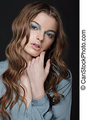 Fantasy. Young Brunette with Unusual Blue Eye Make-up