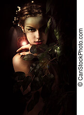 fantasy - young woman styled as a forest nymph, studio shot