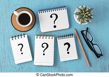 Faq concept - Question marks on notepads on blue wooden ...