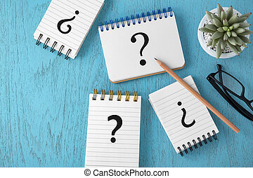 Faq concept with variety of question marks on blue background