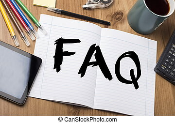 FAQ - Note Pad With Text On Wooden Table