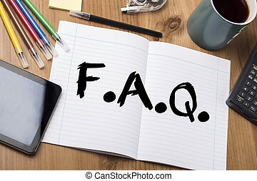 F.A.Q. - Note Pad With Text On Wooden Table