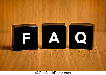 FAQ or Frequently asked questions text on block - FAQ or...