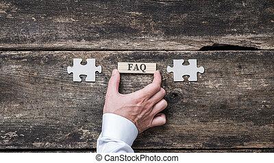 FAQ sign on wooden peg