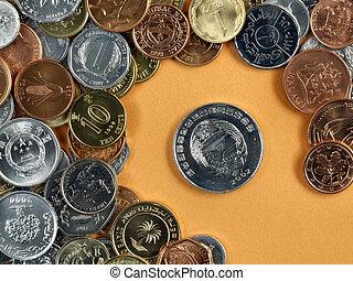 Global trade symbols - currencies on an orange background.
