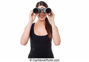 Gorgeous woman viewing through binoculars