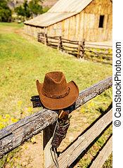 hat and gun in the far west, western spirit