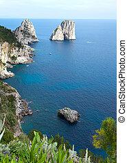 Faraglioni, famous giant rocks, Capri island in Italy