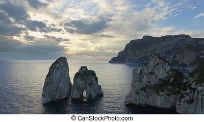 Faraglioni rocks towering up from bright blue Mediterranean....