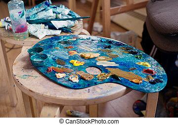 farbować paletę, od, przedimek określony przed rzeczownikami, artysta, jest, na stole, w, przedimek określony przed rzeczownikami, studio sztuki