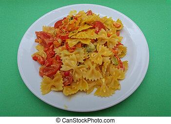 farfalle pasta traditional Italian food with tomato, soy cream and curcuma