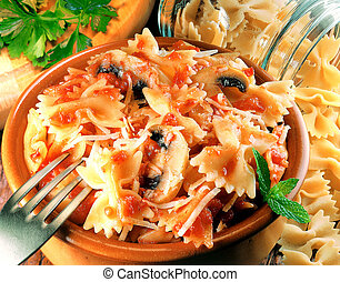 Farfalle with tomato sauce served on clay pot