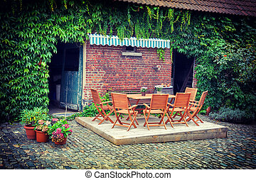 Farm backyard with  table and chairs