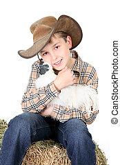 Farm boy holding a chicken