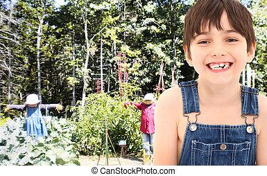 Farm Boy in Garden with Scarecrows