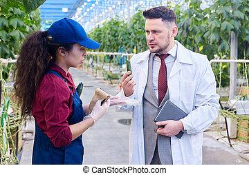 Farm Breeder Talking to Female Worker