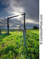 Farm corral with spring flowers and sun star - Old wood...
