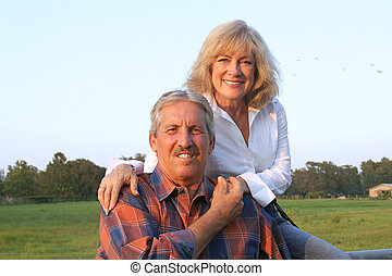 Farm Couple Relaxing - A good-looking farm couple relaxing...