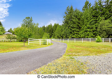 Farm driveway with wooden fence in Olympia, Washington state...