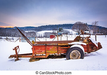 Farm equipment in a snow covered field in rural Carroll County,